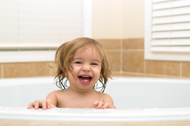 Toddler Happy to be in The Bath Tub royalty free stock photography