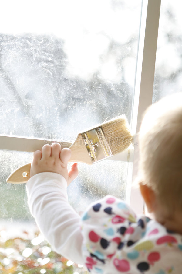 Free Toddler Holding A Paint Brush Stock Photography - 7708472