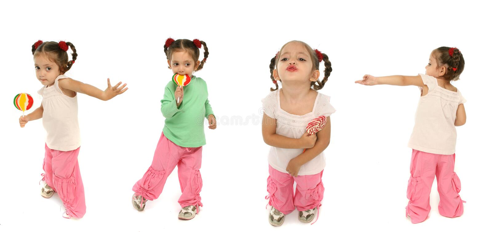 Toddler holding a lollipop wit stock image