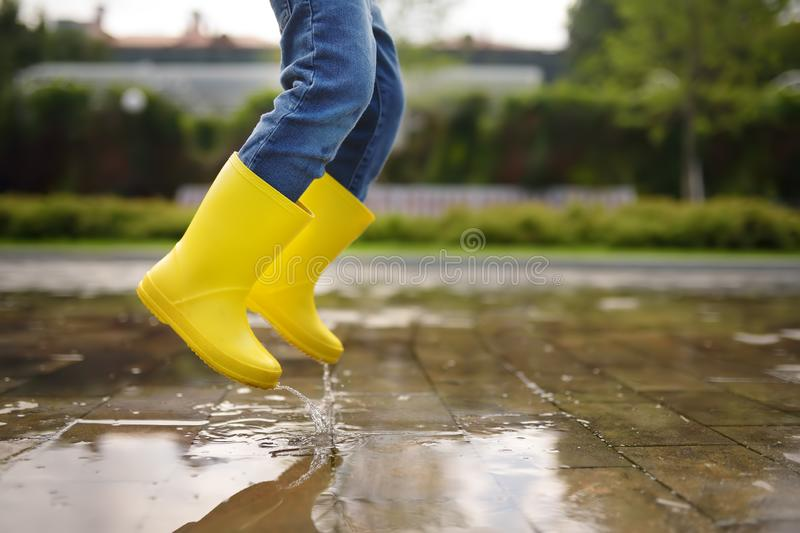 Toddler jumping in pool of water at the summer or autumn day. Outdoors activity for kids stock photos