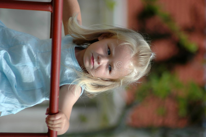 Toddler on jungle gym stock photography
