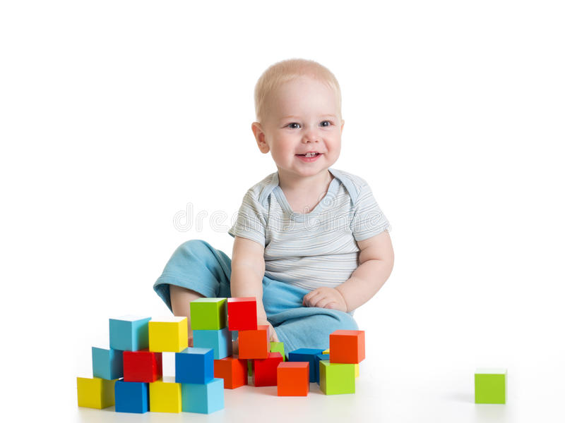 Toddler kid boy playing wooden toys royalty free stock image