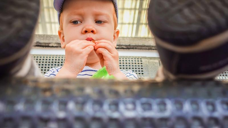 Toddler kid eating outdoors city stock photography