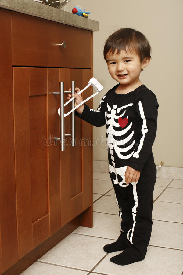 Toddler in kitchen stock photography