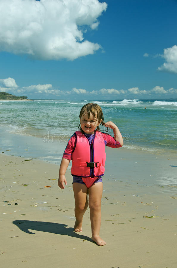 Toddler in life jacket stock image