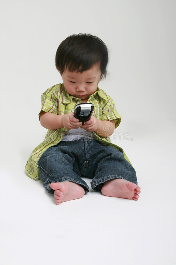 Toddler with Mobile Phone stock images