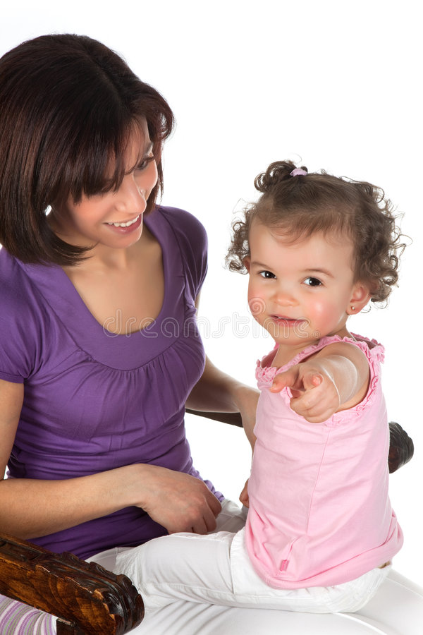 Toddler and mother. Little toddler girl sitting on her mother's lap royalty free stock photos