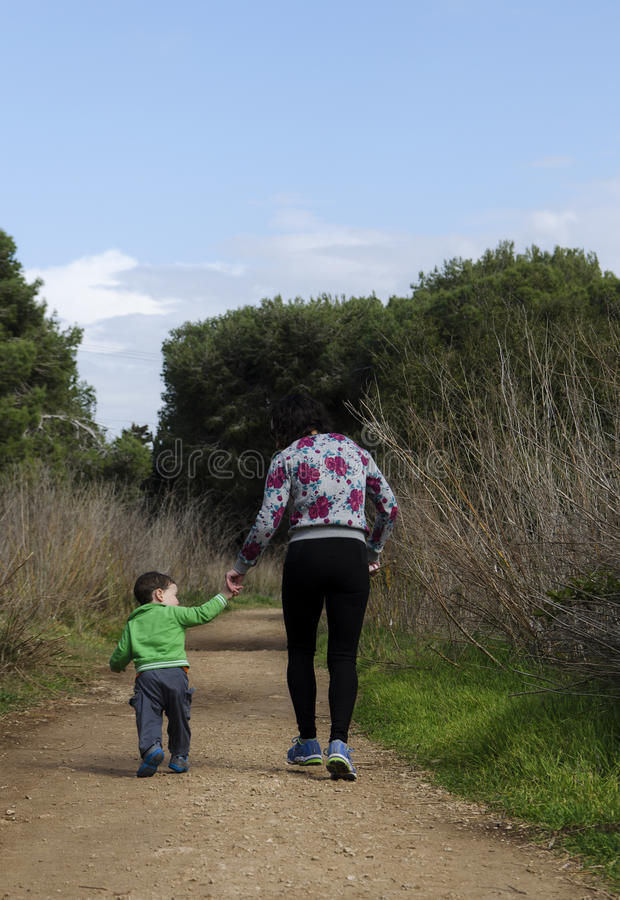 Toddler and mother walking royalty free stock photos