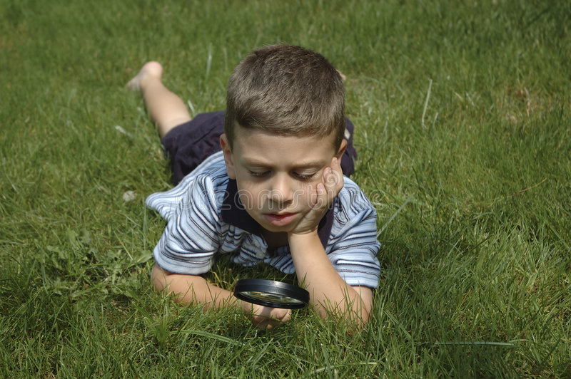 Toddler Observing Nature. Child Observing Nature With Magnifying Glass royalty free stock photo