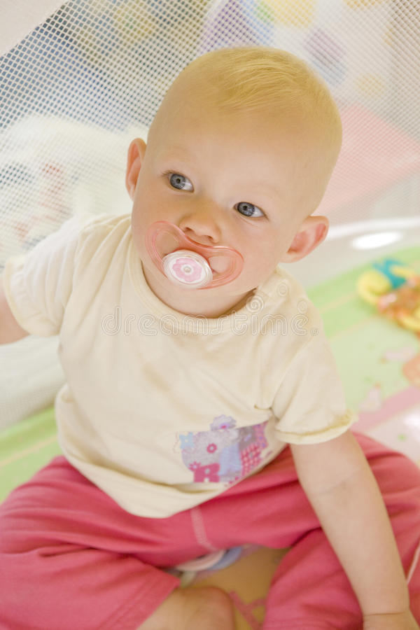 Download Toddler with pacifier stock image. Image of dummy, cots - 11660775