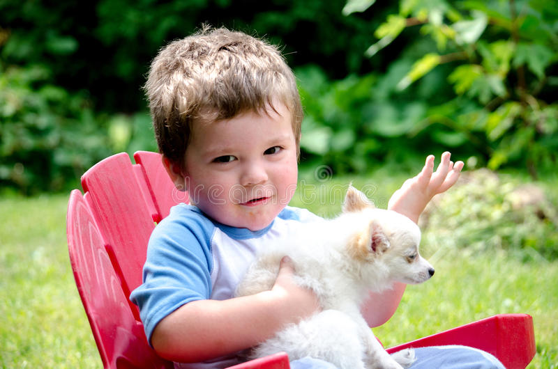 Toddler and pet puppy royalty free stock images