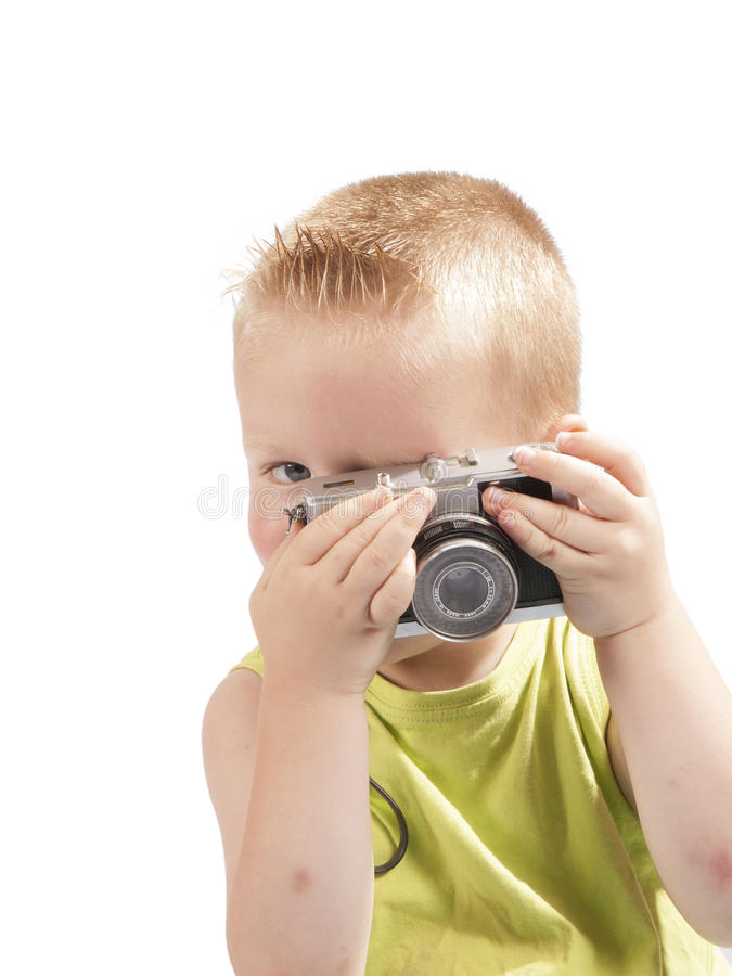 Toddler with a photo camera. On a white background stock photos