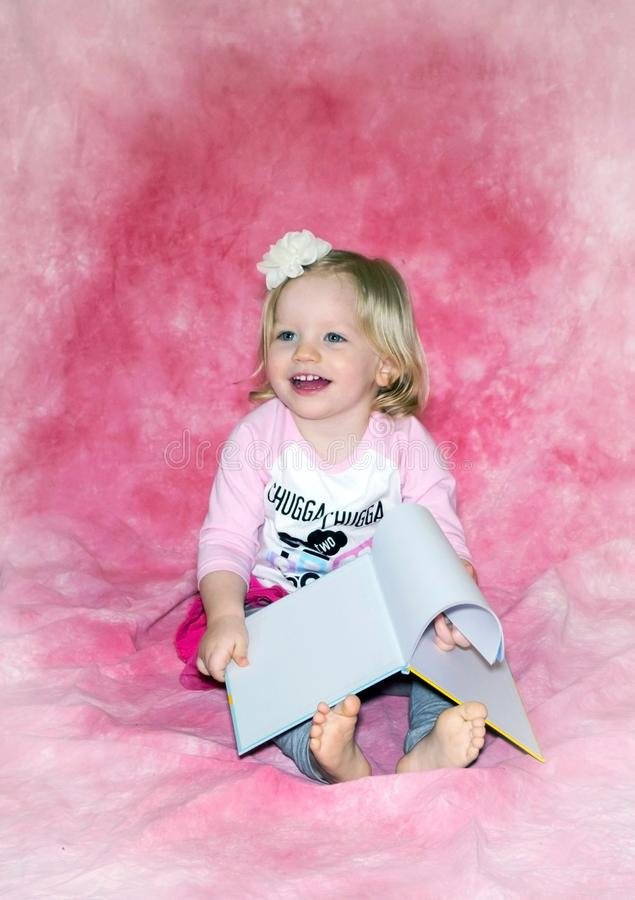 Happy little toddler and picture book stock photography