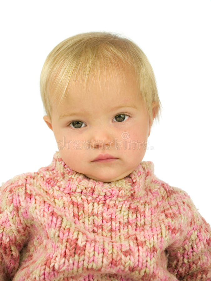 Toddler in pink pullover. Cute thoughtful toddler in pink pullover royalty free stock photo
