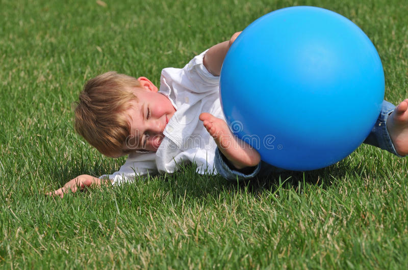Toddler playing with blue ball stock photos
