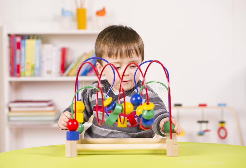 Download Toddler Playing With A Challenging Toy Stock Image - Image: 28866453
