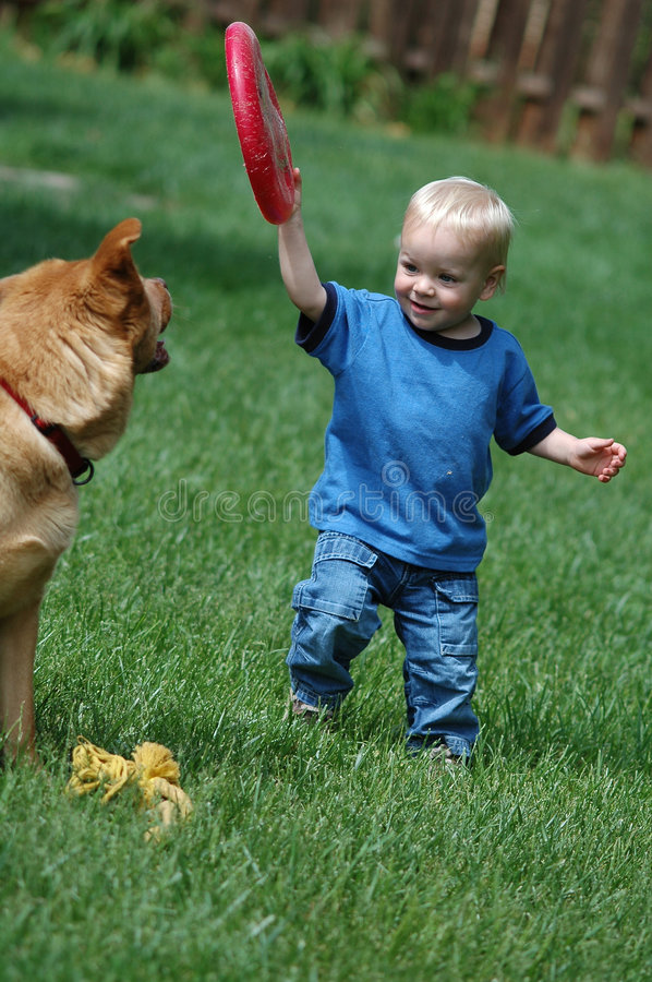 Download Toddler playing fetch game stock photo. Image of green - 655414