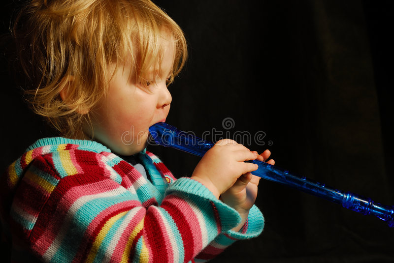 Toddler playing flute