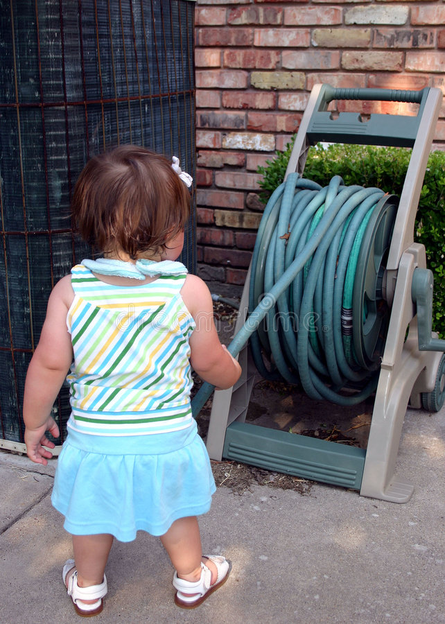 Download Toddler Playing With Garden Hose Stock Image - Image of explore, wall: 165443