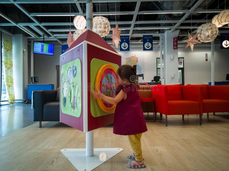 Toddler playing at the IKEA store in Cheras while waiting at the customer service area. Kuala Lumpur, Malaysia - Dec 30, 2019: Toddler playing at the IKEA store royalty free stock image