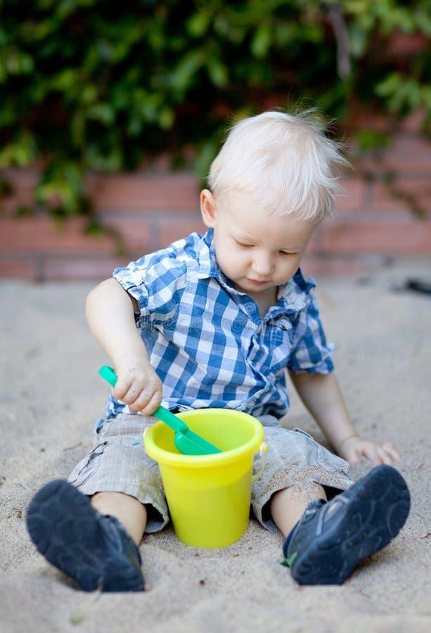 Toddler playing in sandbox royalty free stock images