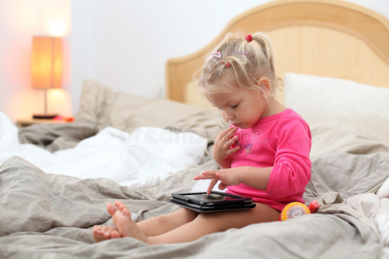 Download Toddler Playing With A Tablet Pc Stock Photo - Image: 28487446