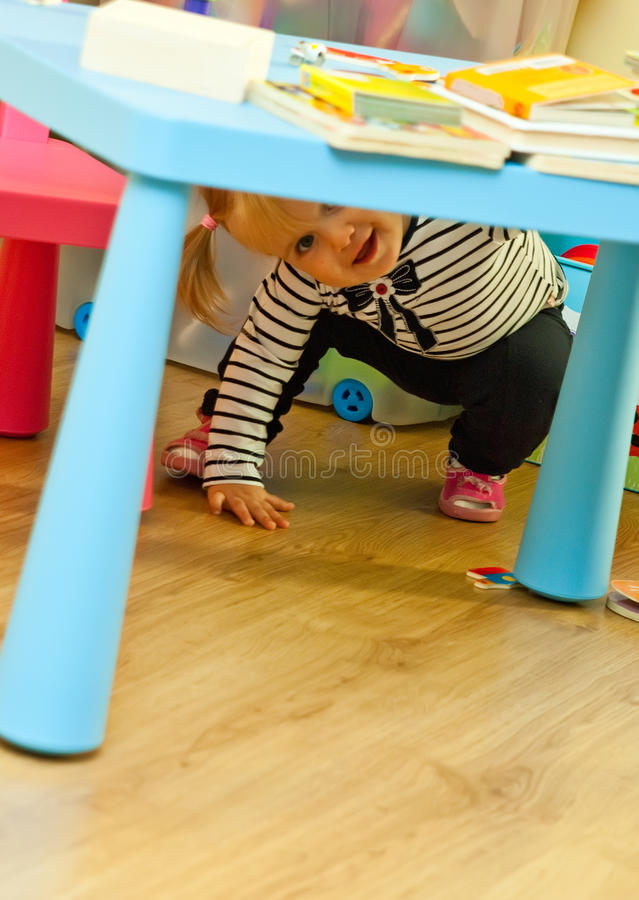 Download Toddler Playing Under Table Stock Image - Image: 21440889