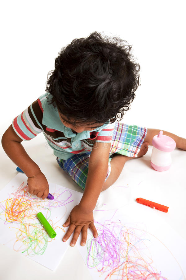Download Toddler Producing Art Work With Crayons Stock Photo - Image: 9924232