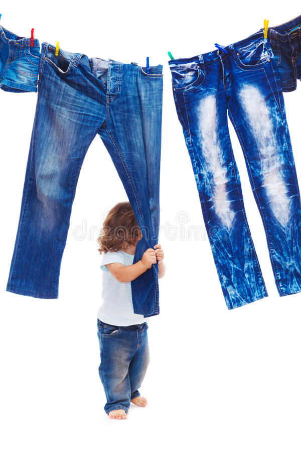 Download Toddler Pulling Denim Clothes Stock Image - Image: 26372395