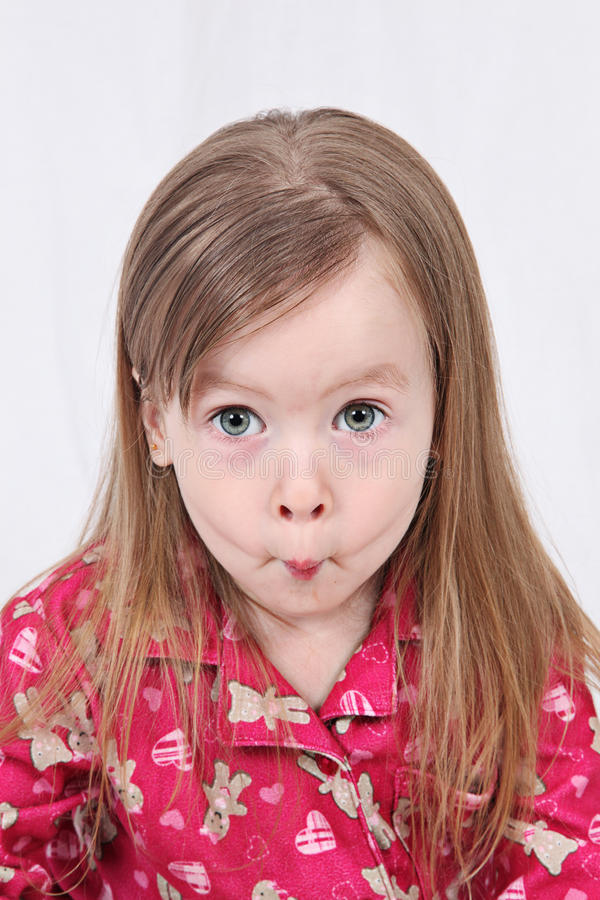 Toddler pulling funny face stock images