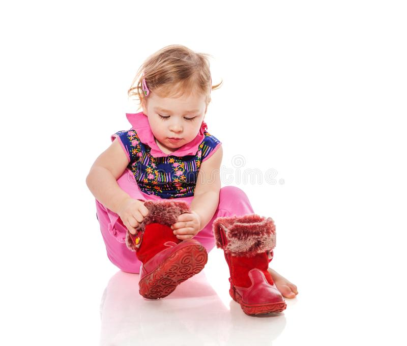 Toddler putting on shoes royalty free stock photo