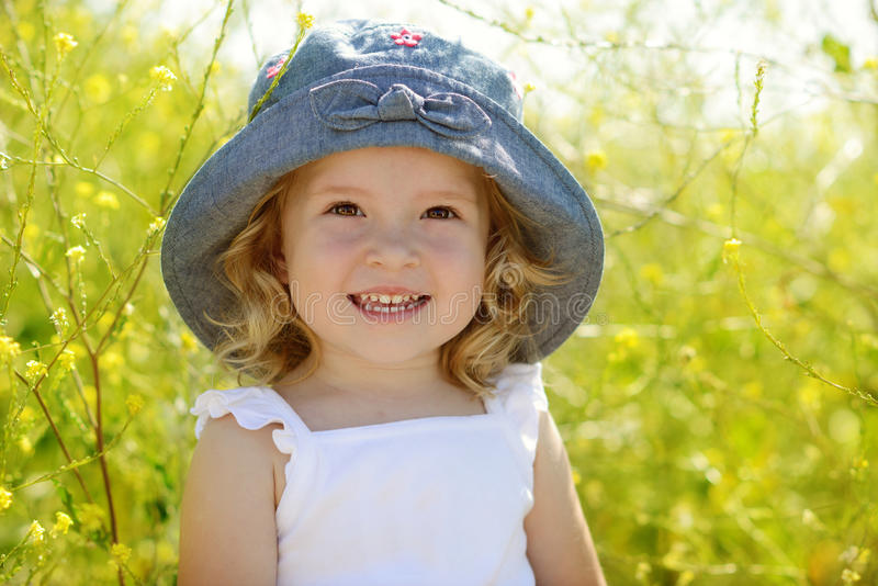 Toddler in field stock images