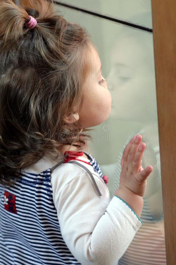 Toddler reflections stock images