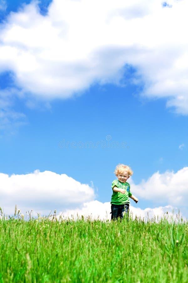 Toddler running stock photos