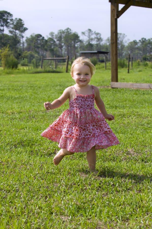 Toddler Running Outdoors Stock Photo