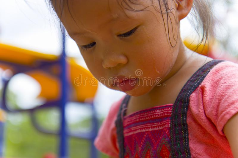 Toddler`s Face looking for something and sweaty on her face. High resolution image gallery royalty free stock images