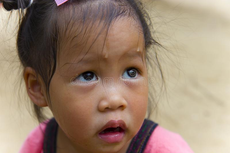 Toddler`s Face looking for something and sweaty on her face. High resolution image gallery royalty free stock photography