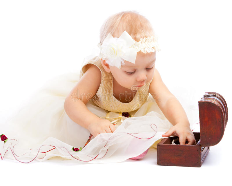 Toddler searching for treasure royalty free stock photo