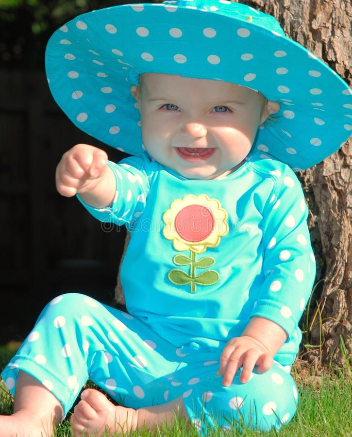 Free Toddler Sitting On Grass In A Polkadot Outfit Stock Images - 19907274