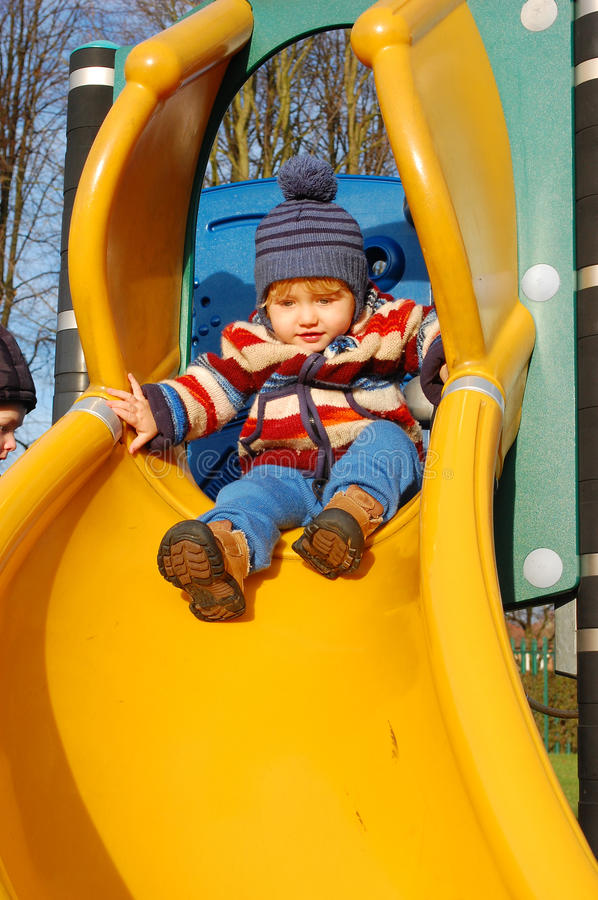 Download Toddler on slide stock photo. Image of active, child - 28607452