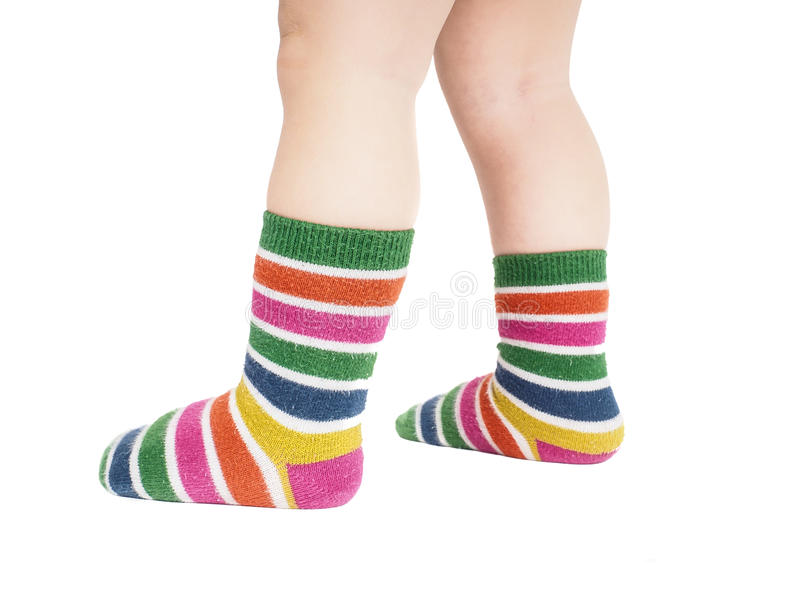 Toddler standing in striped socks and bare legs stock photos