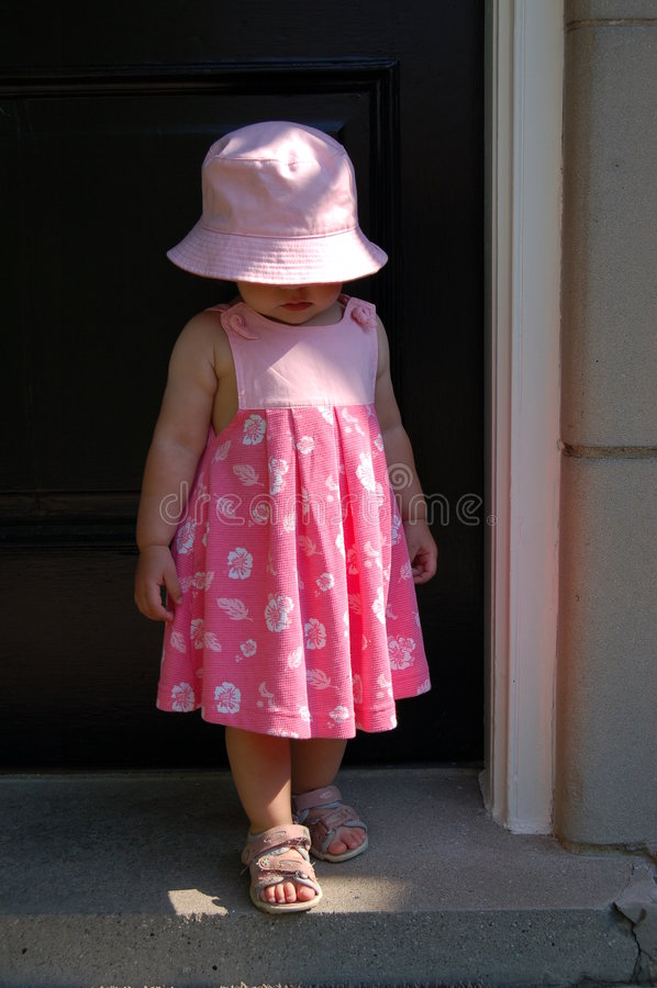 Toddler stepping out into the sunlight stock photos