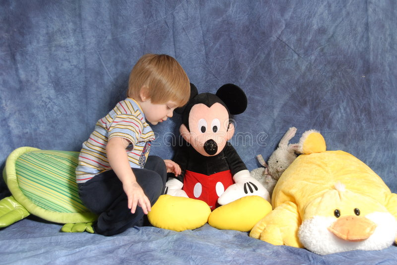Toddler with stuffed animals stock photography