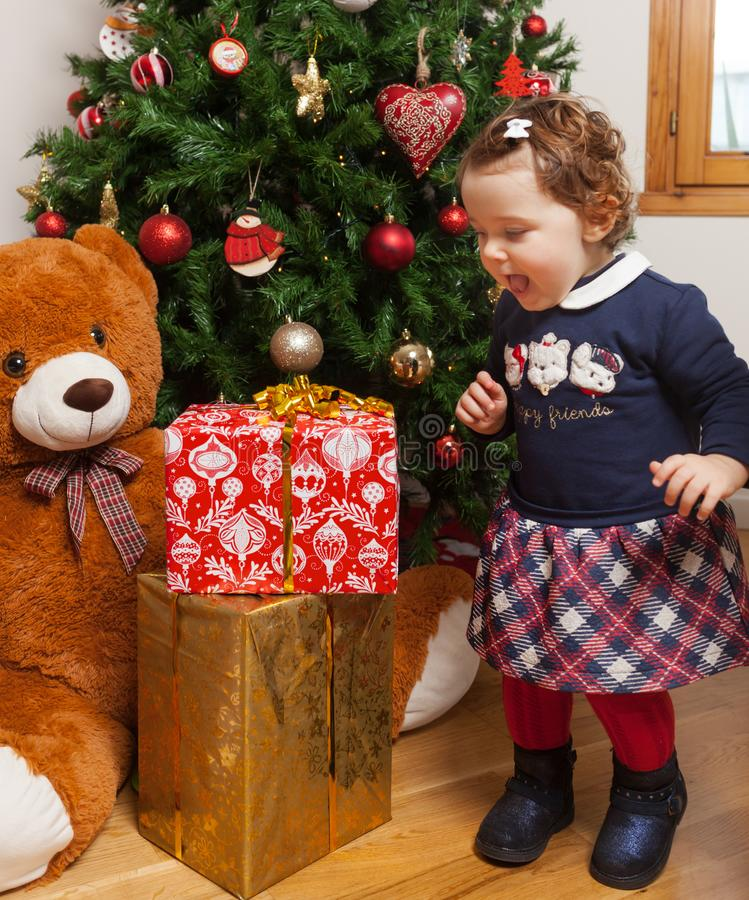 Toddler with surprised expression. Christmas concept. stock photos