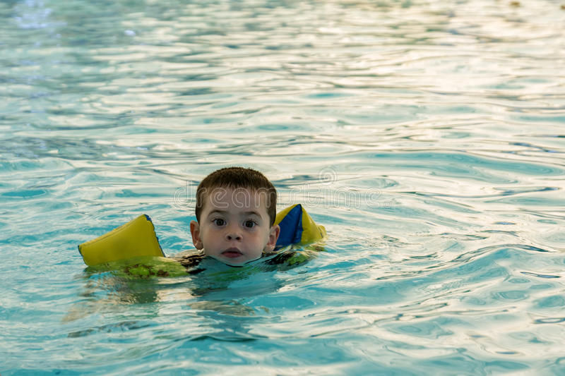 Toddler swimming royalty free stock photography
