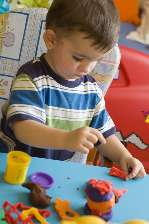 Toddler with toys royalty free stock photos