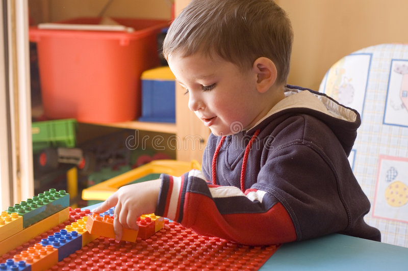 Download Toddler With Toys In His Room Stock Image - Image: 892689
