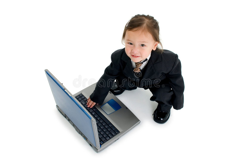 Toddler typing on laptop stock photography