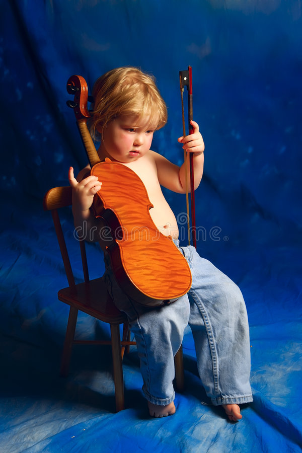 Toddler with violin in blue