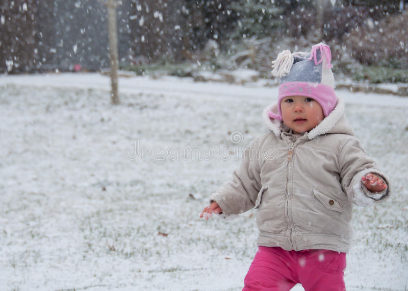 Download Toddler Walking While Its Snowing Out Stock Photo - Image: 27719968